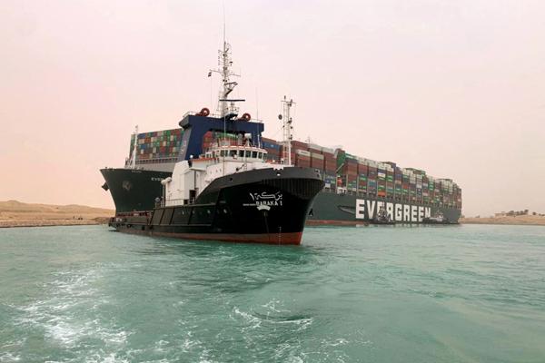 Egypt battles to free ship blocking Suez Canal